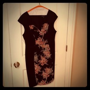 Black dress with floral-print panel on front